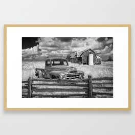 Black and White of Rusted International Harvester Pickup Truck behind wooden fence with Red Barn in Framed Art Print