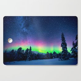 Aurora Borealis Over Wintry Mountains Cutting Board