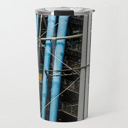Colored pipelines on the facade of a building Travel Mug