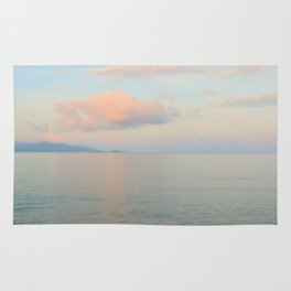 Calm silver sea and coloured clouds Rug