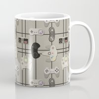 video game Mugs featuring Paper Cut-Out Video Game Controllers by Jaana Baker