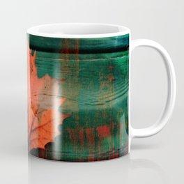 Rusty red dried fall leaf on wooden hunter green beams Coffee Mug