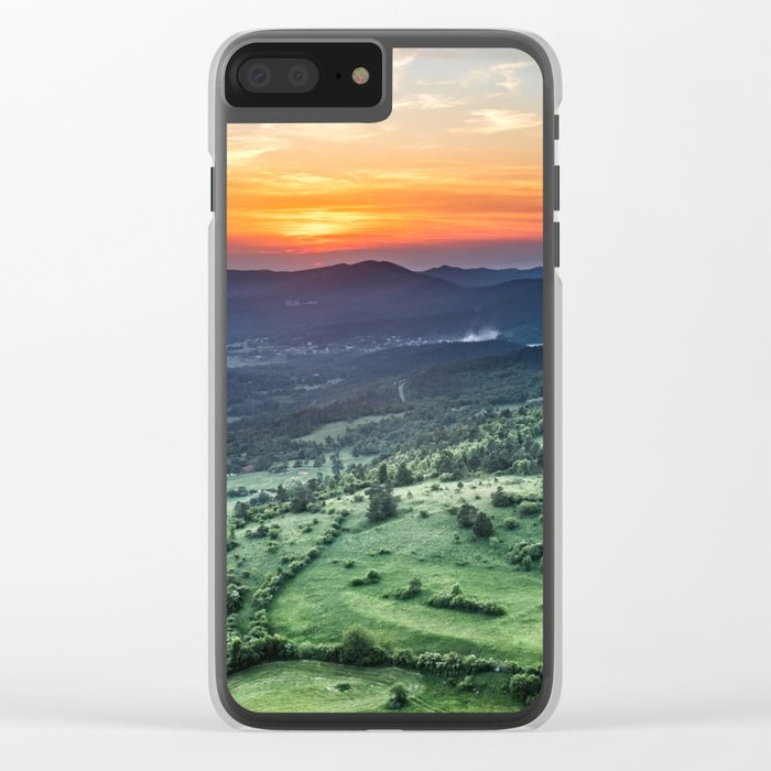 Beautiful sunset behind green fields Clear iPhone Case