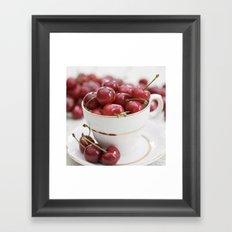 Cherries in a teacup Framed Art Print