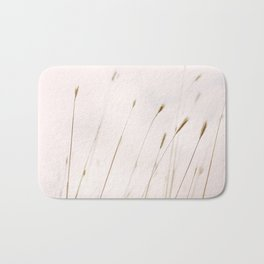 Tall grass against cloudy sky Bath Mat