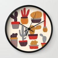 alisa burke Wall Clocks featuring Kaktus by Annisa Tiara Utami
