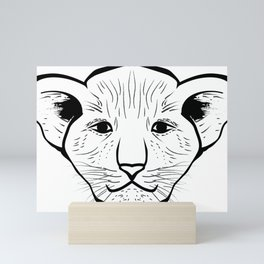 Black silhouette of a lion cub face. Lovely lion for pam, moms and toddlers, accessories. Mini Art Print