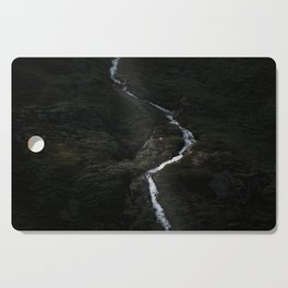 Dark forest with waterfall on the side of a mountain in Norway - Landscape Photography Cutting Board
