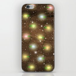 Christmas lights on wooden background iPhone Skin