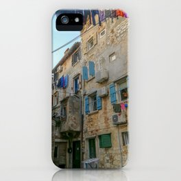 Little alley in the medieval center of the village Rovinji at sunset iPhone Case