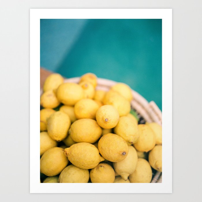 Yellow lemons next to a turquoise pool.   Colorful food photography, tropical feel. Art Print