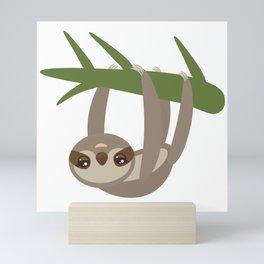 Three-toed sloth on green branch on white background Mini Art Print
