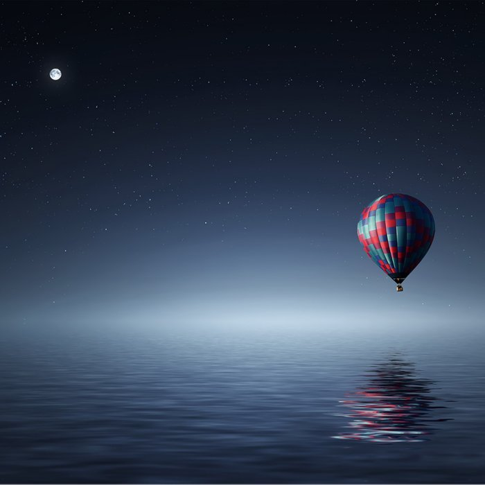 Hot Air Balloon Over Water Comforters