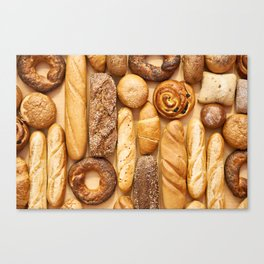 Bread baking rolls and croissants background Canvas Print