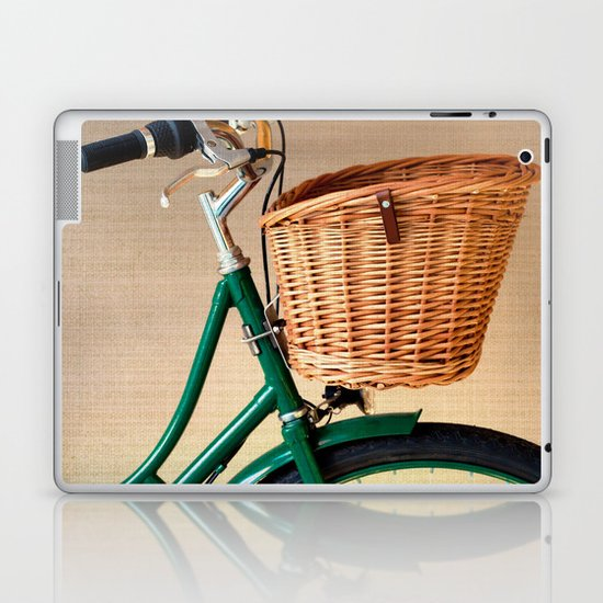 Vintage green bicycle with basket and textured background  Laptop & iPad Skin
