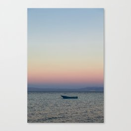 rowboat and rainbow sky Canvas Print