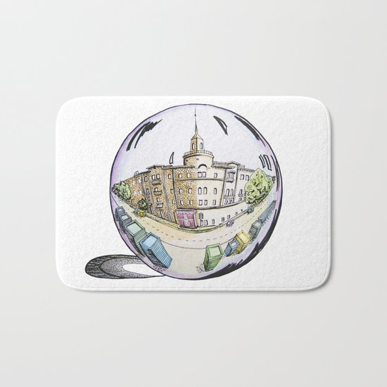 the city painted in pastel colours and in a bowl Bath Mat