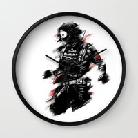 the winter soldier Wall Clocks featuring The Winter Soldier by Ashqtara