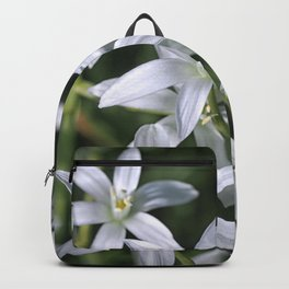 Macro photo of a white flower Backpack