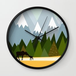Woodland snowy mountain tops trees and mother moose and baby Wall Clock