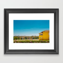 Yellow house with a view Framed Art Print