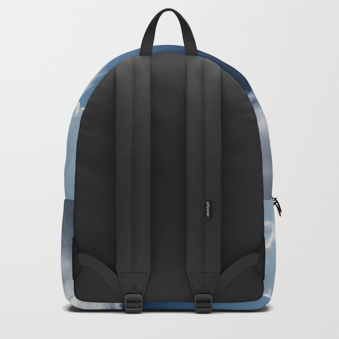 Sky, clouds and lights. Backpack