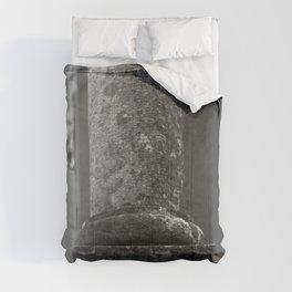 Stone column of a grey sky Comforters