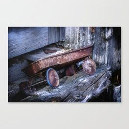 Left and Forgotten a little red wagon Canvas Print