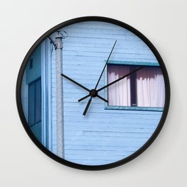 vintage blue wood building with window and electric pole Wall Clock