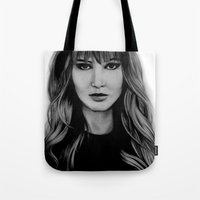 jennifer lawrence Tote Bags featuring Jennifer Lawrence by Lydia Dick
