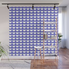Cross sparkling pattern of blue hearts on a light background. Wall Mural
