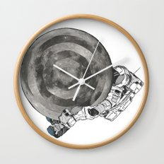 Troubled Moons and Spacemen Wall Clock