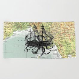 Octopus Attacks Ship on map background Beach Towel