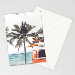 Vintage car parked on the tropical beach (seaside) with a surfboard on the roof - Leisure trip in the summer. retro color effect Stationery Cards