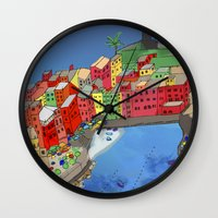 paper towns Wall Clocks featuring Towns of Italy by Louise Griffiths
