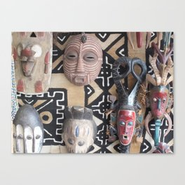 African Mask display on fabric collection Canvas Print
