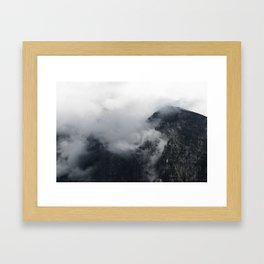 White clouds over the dark rocky mountains Framed Art Print