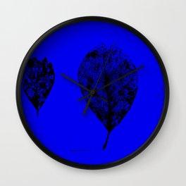 Black skeleton leaves on blue Wall Clock