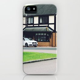 Luxury residential house with green hedge and landscaping in front. iPhone Case
