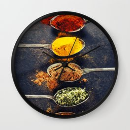 Colorful spices in metal spoons Wall Clock