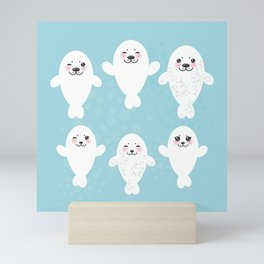 Funny white fur seal pups, cute seals with pink cheeks and big eyes. Kawaii albino animal Mini Art Print
