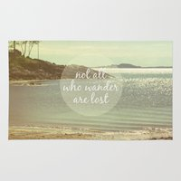 not all who wander are lost Area & Throw Rugs featuring Not All Who Wander Are Lost by Jillian Audrey