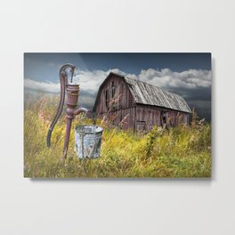 Weathered Wooden Barn with Water Pump and Metal Bucket Metal Print