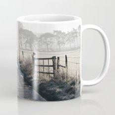 Remote frozen country road a t sunrise. Norfolk, UK. Mug