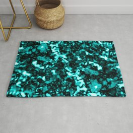 A bright cluster of light blue bodies on a dark background. Rug