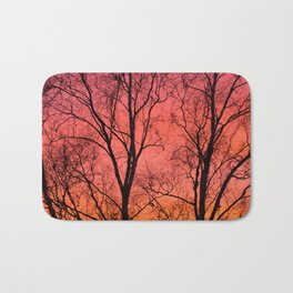 Tree Silhouttes Against The Sunset Sky #decor #society6 #homedecor Bath Mat