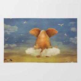 Sad elephant sitting on cloud in  sky  Rug