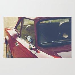 Sportscar, supercar, windscreen details, red triumph spitfire, english car Rug