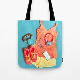 Fitness at gym activewear workout clothes with kettlebell listening to music on phone Tote Bag