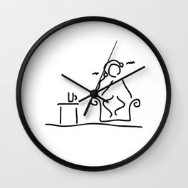 in the armchair music hearing relaxing Wall Clock